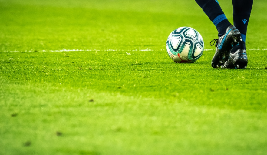 Photo of a footballer with the ball at their feet