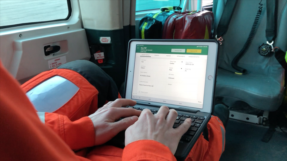 HEMS paramedic using ARCEMS in a helicopter