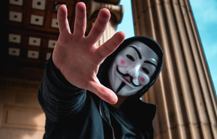 Photo of a man in an anonymous mask