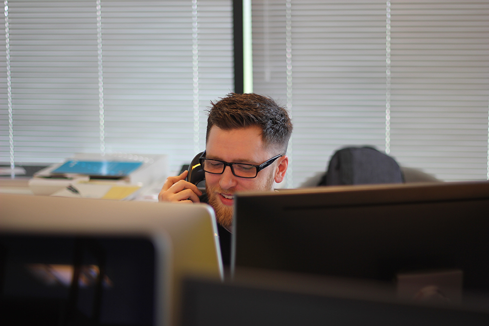 Photo showing a customer support worker on a telephone